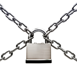 Under protection , locked up security concept. Pad lock with chains on a white background.